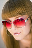 Young woman wearing sunglasses. Young white woman wearing sunglasses Royalty Free Stock Photo
