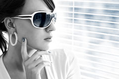 Young woman wearing sunglasses Stock Images