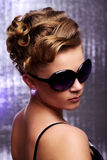 Young woman wearing sunglasses. Stock Images