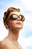 Young woman wearing sunglasses Stock Photography