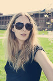 Young woman wearing sunglasses. Young beauty blonde woman wearing sunglasses outdoor in summer Stock Photography