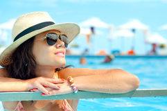 Young woman wearing sunglasses enjoying water and sun Royalty Free Stock Photography