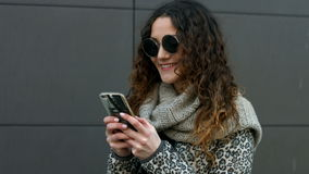 Young woman wearing sunglasses happy to get a message from his boyfriend. Young woman wearing sunglasses happy to get a message from  his boyfriend stock video footage