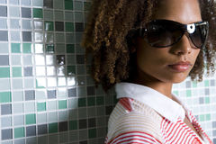 Young woman wearing sunglasses, portrait, close-up Royalty Free Stock Photography
