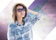 Young woman wearing sunglasses and smiling. Against wooden background Royalty Free Stock Photos