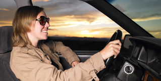 Young Woman Wearing Sunglasses Smiling and Driving Stock Images