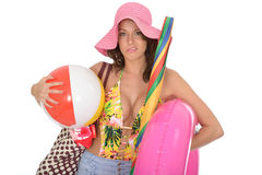 Young Woman Wearing a Swim Suit on Holiday Carrying a Beach Ball Royalty Free Stock Images