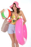 Young Woman Wearing a Swim Suit on Holiday Carrying a Beach Items Royalty Free Stock Photo