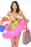 Young Woman Wearing a Swim Suit on Holiday Carrying a Bucket and Spade Stock Images