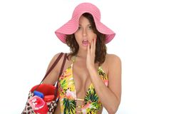 Young Woman Wearing a Swim Suit and a Pink Straw Hat on Holiday Royalty Free Stock Photos
