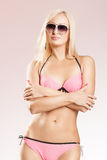 Young woman wearing swimwear and sunglasses Stock Photography