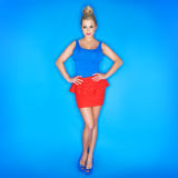Young Woman Wearing Tank Top And Red Skirt. On Blue Background Royalty Free Stock Photography