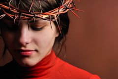 Young woman wearing thorn crown Royalty Free Stock Photo