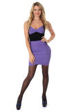 Young Woman Wearing Tight Purple Short Mini Dress and High Heel Shoes royalty free stock photos