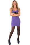 Young Woman Wearing Tight Purple Short Mini Dress and High Heel Shoes Royalty Free Stock Photo