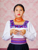 Young woman wearing traditional andean dress, facing camera doing sign language word for interpret Royalty Free Stock Images