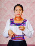 Young woman wearing traditional andean dress, facing camera doing sign language word for interpret Royalty Free Stock Photo