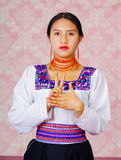 Young woman wearing traditional andean dress, facing camera doing sign language word for laugh Stock Images