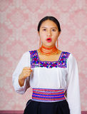 Young woman wearing traditional andean dress, facing camera doing sign language word for man Stock Photo