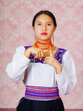 Young woman wearing traditional andean dress, facing camera doing sign language word for month Royalty Free Stock Photography