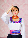 Young woman wearing traditional andean dress, facing camera doing sign language word for must Stock Photo