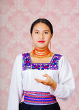 Young woman wearing traditional andean dress, facing camera doing sign language word for pain Stock Photography