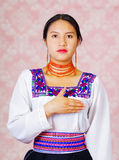 Young woman wearing traditional andean dress, facing camera doing sign language word for please Stock Photos