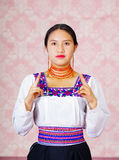 Young woman wearing traditional andean dress, facing camera doing sign language word for recognize Royalty Free Stock Images