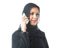 Young Woman Wearing Traditional Arabic Clothing. Studio shot of young woman wearing traditional arabic clothing, talking on phone Royalty Free Stock Photo