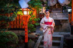 Young woman wearing traditional japanese kimono Stock Photography