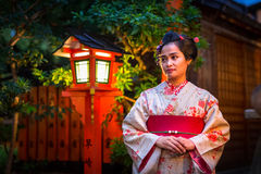 Young woman wearing traditional japanese kimono. KYOTO, JAPAN - NOVEMBER 10, 2016: Young woman wearing traditional japanese kimono walk on the street of Gion Royalty Free Stock Photos