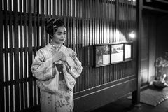 Young woman wearing traditional japanese kimono walk on the street of Gion, Kyoto Stock Images
