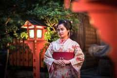 Young woman wearing traditional japanese kimono walk on the street of Gion, Kyoto Stock Photo
