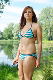 Young woman wearing triangle bikini set Stock Image