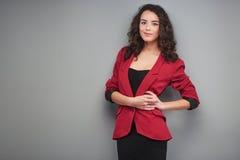 Young woman wearing vinous jacket Stock Photos
