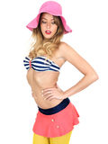 Young Woman Wearing Vintage Bikini and a Straw Sun Hat Royalty Free Stock Images