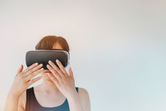 Young woman wearing virtual reality goggle Stock Photography