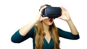 Young woman wearing virtual reality goggles headset, vr box. Connection, technology, new generation and progress concept. Studio royalty free stock images
