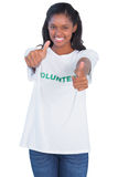 Young woman wearing volunteer tshirt and giving thumbs up Royalty Free Stock Photo