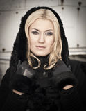 Young woman wearing warm black coat Royalty Free Stock Image