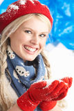 Young Woman Wearing Warm Winter Clothes And Hat Stock Photo