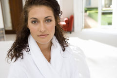 Young woman wearing white bath robe, portrait, close-up Stock Photo
