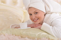 Young woman wearing a white bathrobe Royalty Free Stock Images