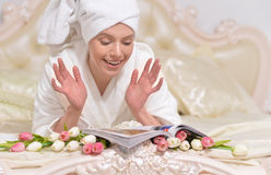 Young woman wearing a white bathrobe Stock Images