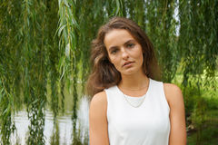 Young woman wearing white dress in a park Royalty Free Stock Photography