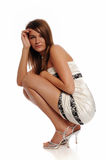 Young Woman wearing a white dress posing Stock Photo