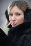 Young woman wearing winter clothes Royalty Free Stock Images