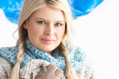 Young Woman Wearing Winter Clothes In Studio Royalty Free Stock Photos