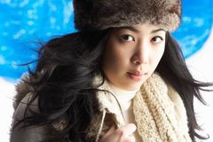 Young Woman Wearing Winter Clothes In Studio Stock Photography