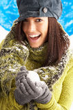 Young Woman Wearing Winter Clothes In Studio Stock Photo